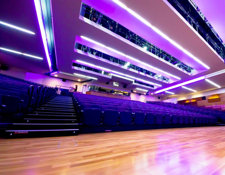 full cinema seating with wide floor area to the front of the room.  Ceiling mounted track lighting and Projection room.