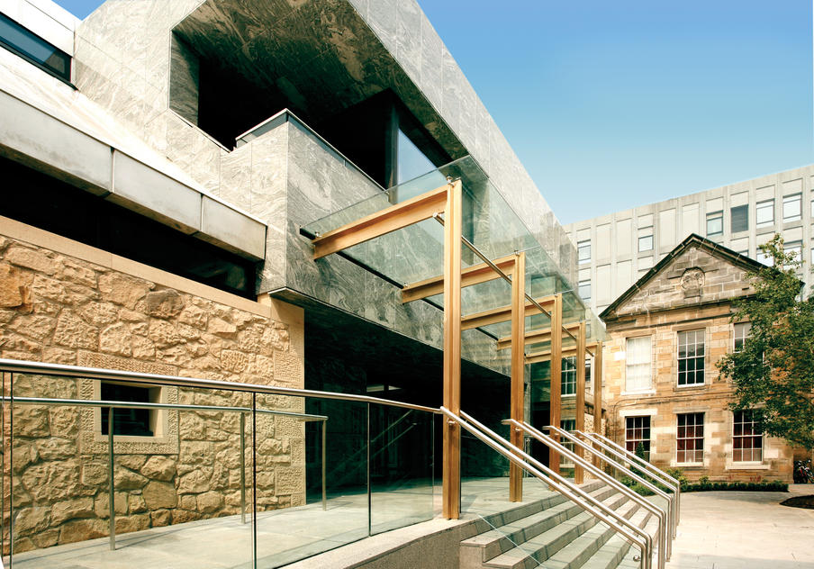 Modern exterior of the conference centre within a courtyard setting.
