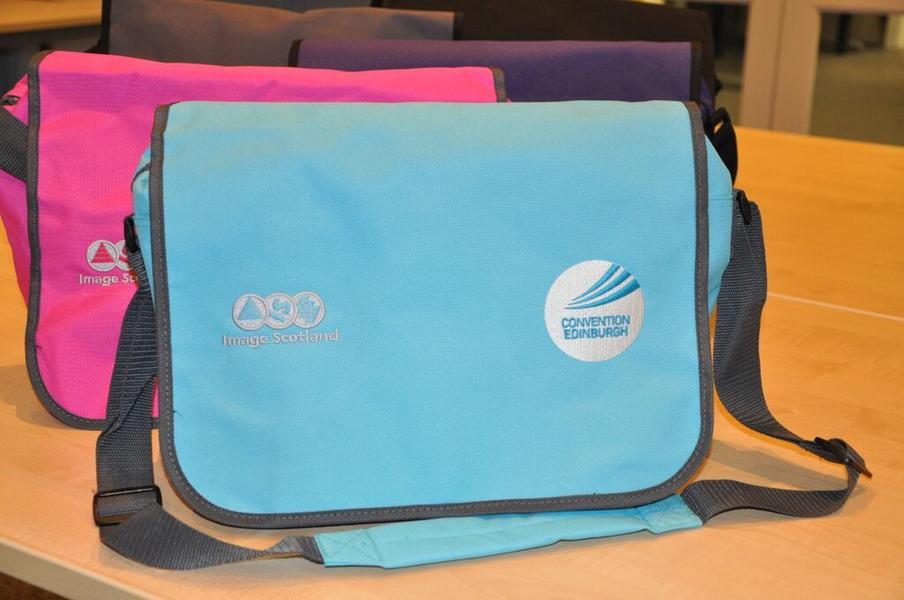 Conference bags in blue and pink (other colours available) and with multiple embroidered logos.