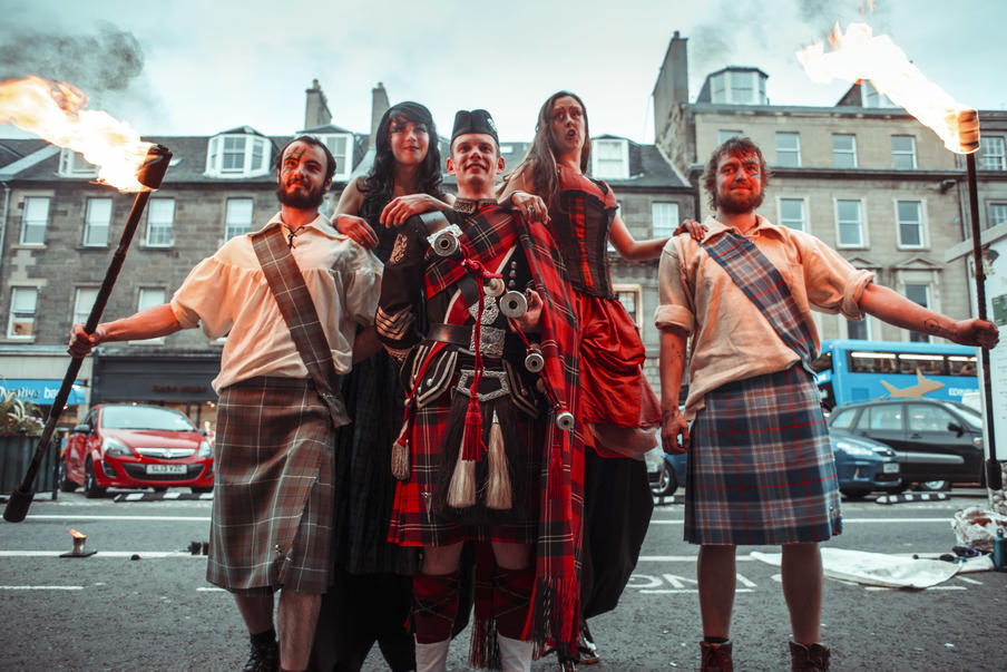 Roddy the Piper with fire performers and stilt walkers provide a Scottish welcome for gala dinner