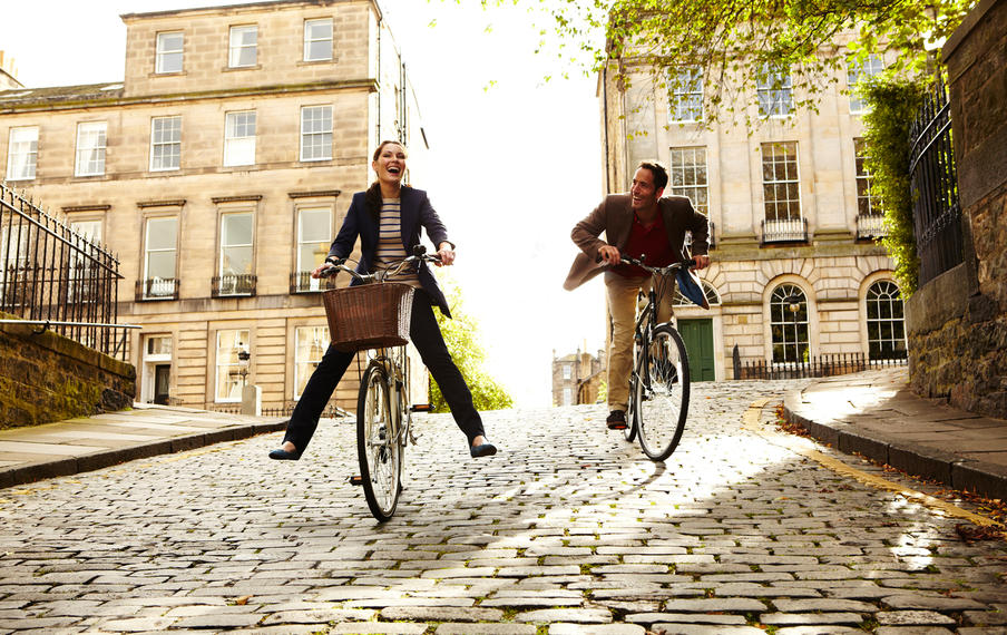 Cyclists  enjoying the cobbled streets of Edinburgh