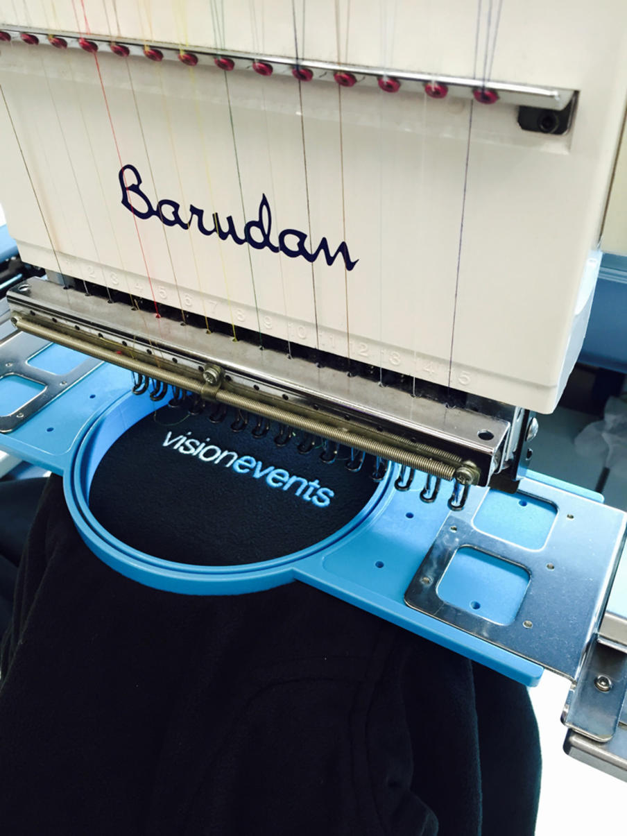 Clothing embroidered at our in-house production centre.