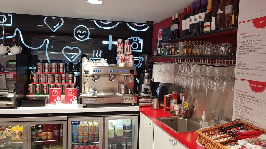 <img src=&quot;cafeathaymarkethubhotel.jpg&quot; alt=&quot;cafe with coffee machine different hot and cold drinks and snacks&quot;>