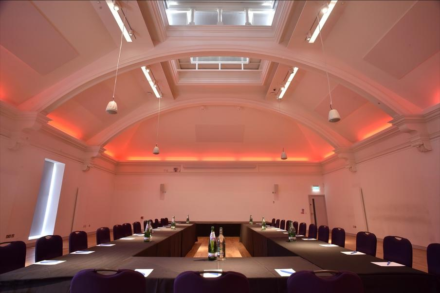 Deacon Suite set up boardroom style with changeable lighting.