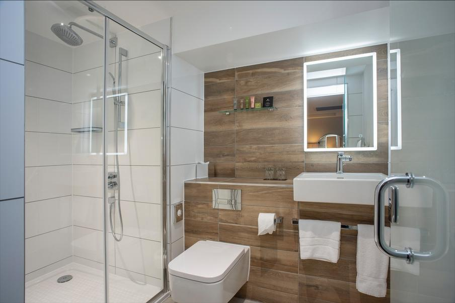 Beautiful new bathrooms with large shower and excellent lighting.