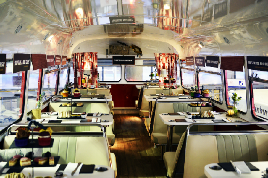 The interior of a 1966 Routemaster bus fitted out as a rolling restaurant